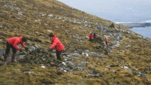 Brown Group members build cairns