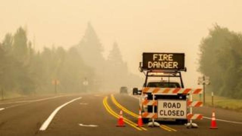 A sign warning of impending fire danger is posted on 10 September