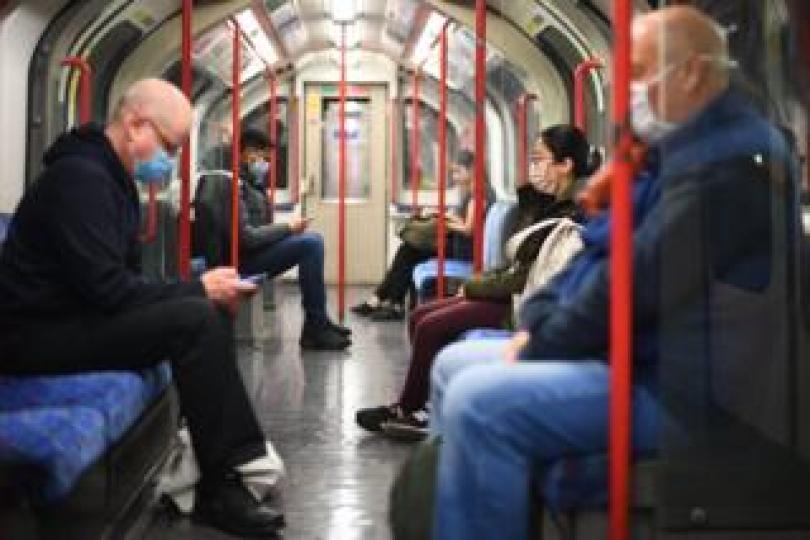Passengers wearing face masks on an underground train