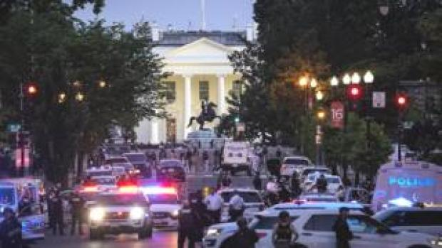 The scene at the White House, showing dozens of police vehicles and a huge presence of armed officers near the building