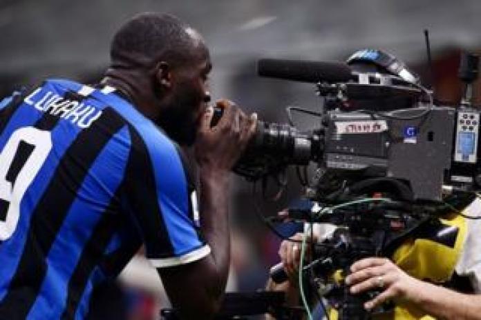 Inter Milan's Belgian player Romelu Lukaku kisses the lens of a live television camera