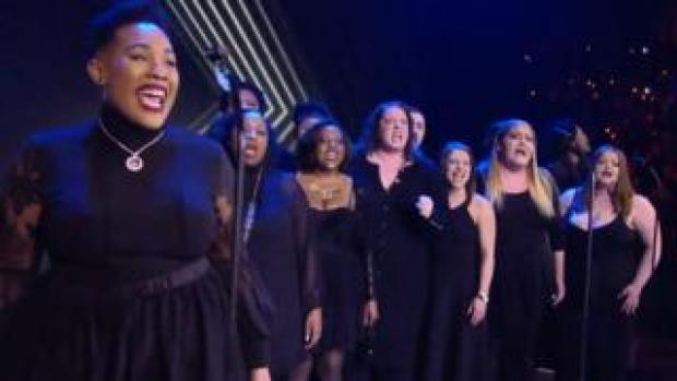 A choir performing at AEW Revolution