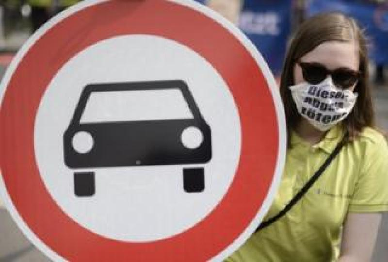 "Protester in Germany wears a mask that reads: ""Diesel emissions kill"""