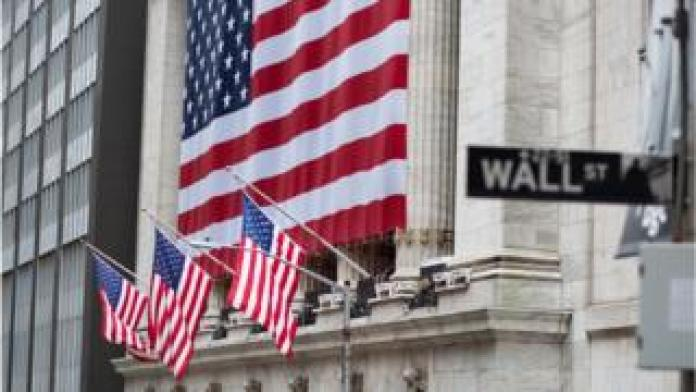 Flags fly full staff outside the NYSE April 9, 2020 in New York