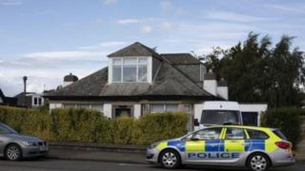Police searching a house in Edinburgh after a man is arrested at Heathrow Airport
