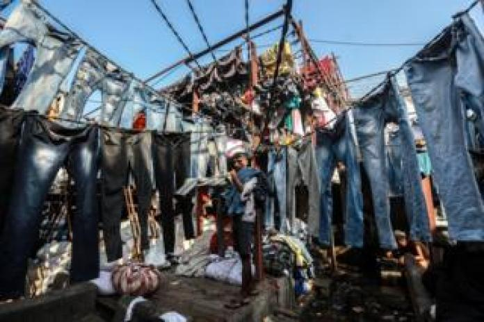 A dhobi hangs out washed clothes at the Mahalaxmi Dhobi Ghat in Mumbai, India