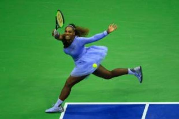 Serena Williams returns the ball during her women's singles second-round match at the US Open in New York