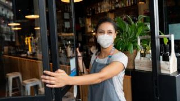 A cafe worker wearing a mask
