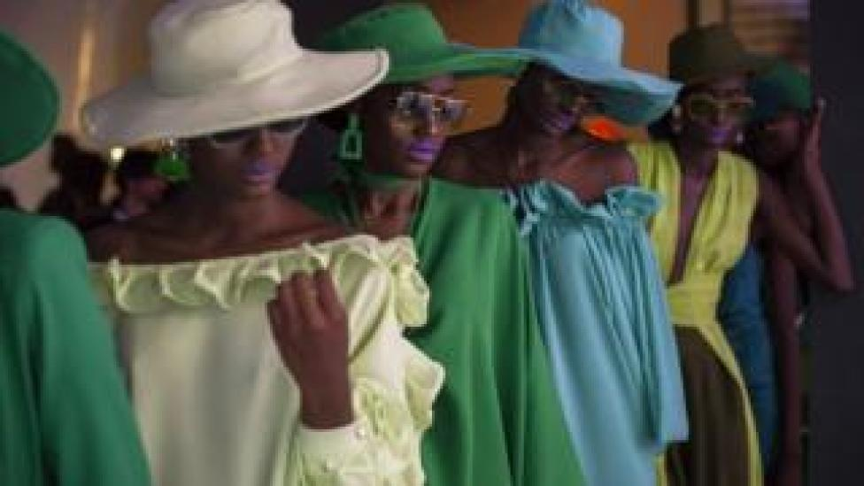 A group of models wearing Sisters of Afrika designs during Dakar Fashion Week in Dakar, Senegal