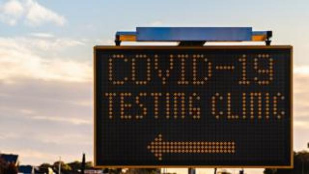 Covid-19 testing clinic sign with arrow