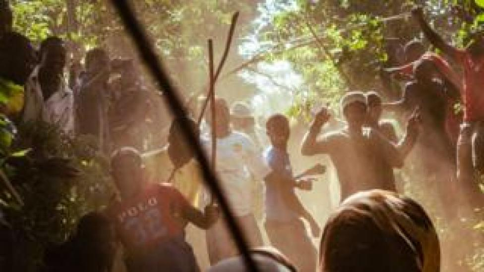People cheering on bulls during a fight in western Kenya