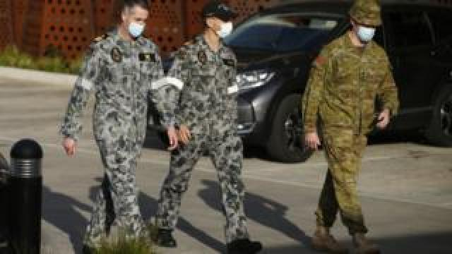 Military staff are seen at Epping Gardens Aged Care Facility in Epping, outskirts of Melbourne, Australia