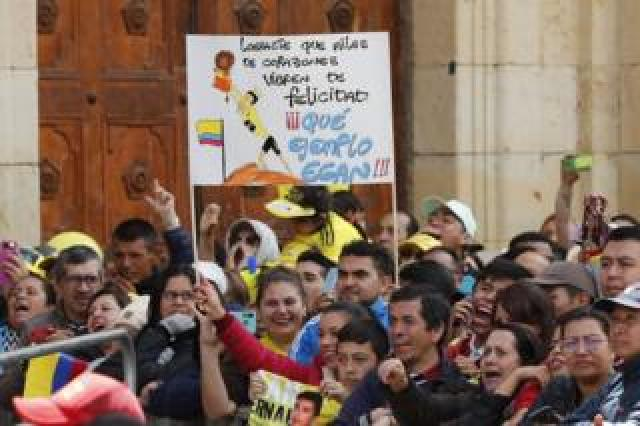 """Fans hold a sign that reads """"You made millions of hearts shake with happiness. What an example, Egan!"""" during a tribute to Colombian cyclist Egan Bernal, winner of the Tour de France 2019, at his hometown, Zipaquira, in Cundinamarca, Colombia"""