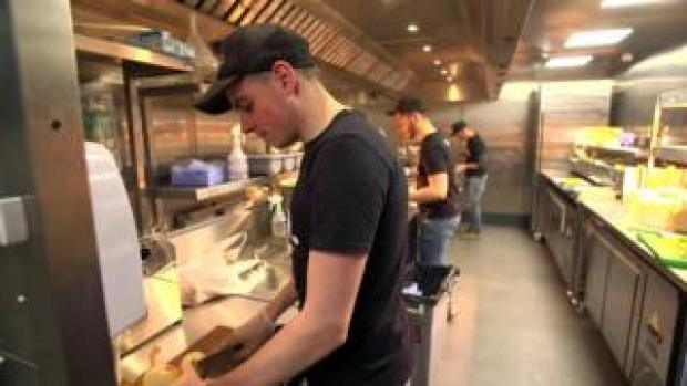 workers in a Deliveroo kitchen
