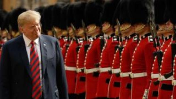 US President Donald Trump inspects the guard of honour formed of the Coldstream Guards during a welcome ceremony at Windsor Castle in Windsor, west of London