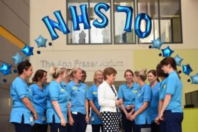 Scotland's First Minister Nicola Sturgeon speaks to NHS staff at the Royal Hospital for Children in Glasgow