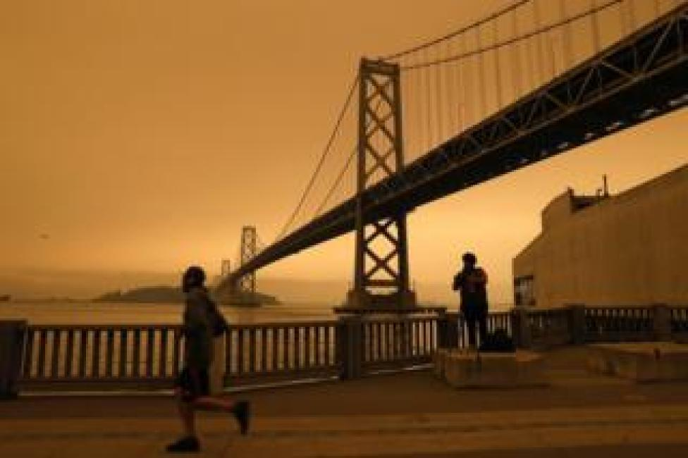 A view of the San Francisco Bay Bridge under an orange overcast sky in the afternoon in San Francisco, California, USA, on 9 September 2020