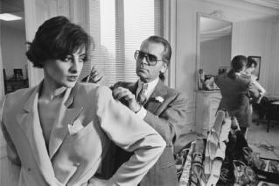 Karl Lagerfeld fits one of his designs on top model Ines de la Fressange at Chloe's Paris studio.