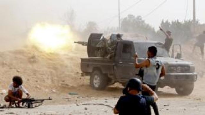Young men fire heavy machine guns - Saturday 25 May 2019