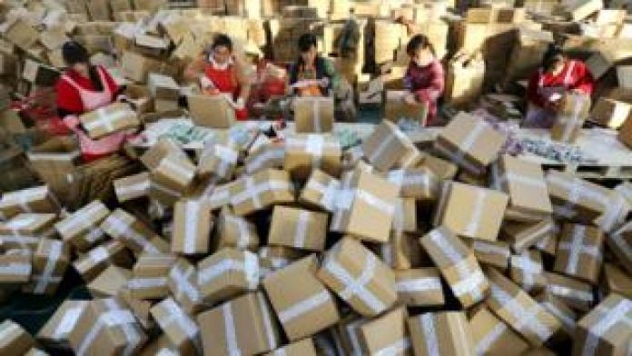 Workers prepare packages for delivery at a sorting centre in Lianyungang, Jiangsu province during the Singles Day online shopping festival on 11 November 2016.