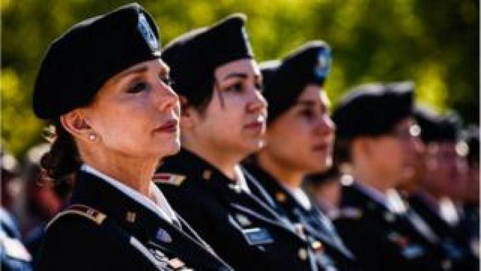 Nation breaking news Chief Warrant Officer Four, Rosemary Masters, of Oklahoma Army National Guard, left, listens to the speaker during the 20th Anniversary of Women In Military Service For America Memorial celebration on Saturday, October 21, 2017, at the Arlington National Cemetery in Arlington, VA.