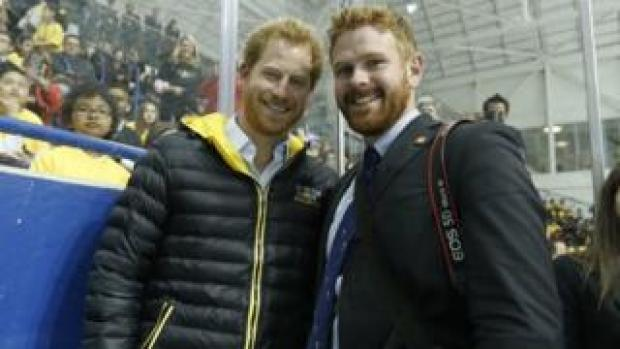 Prince Harry (L) and photographer Adam Scotti (R)