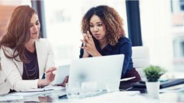 White woman and black woman in office (file picture)