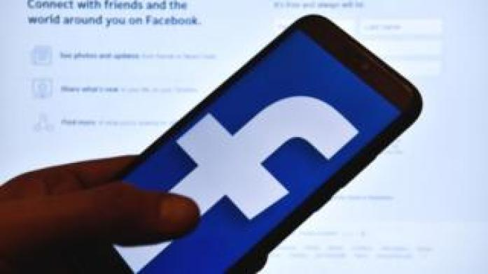 The Facebook logo on a smartphone