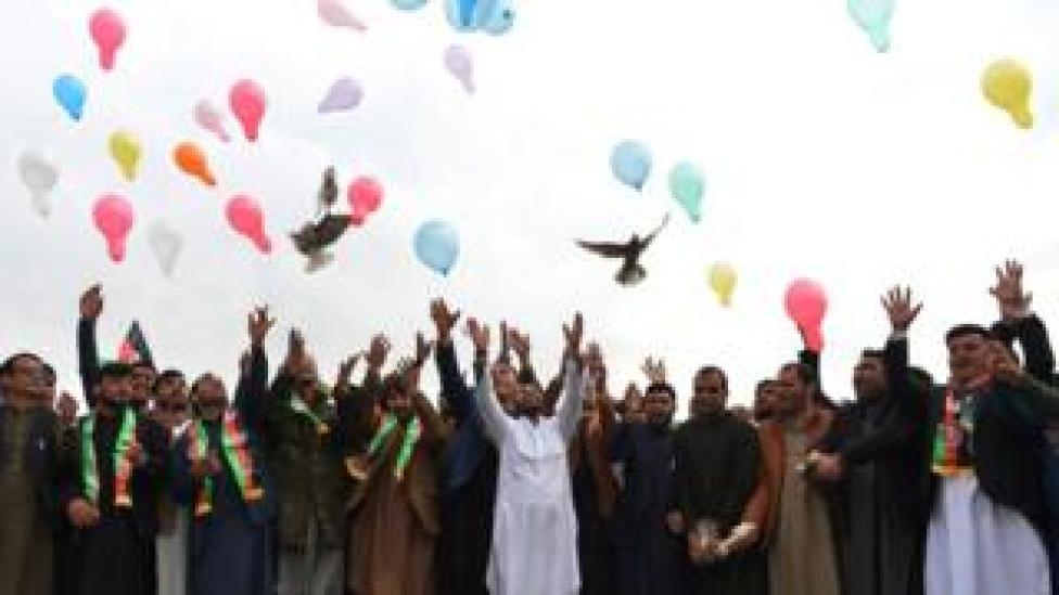 trump Youth release balloons and pigeons as they celebrate the reduction in violence, in Jalalabad on 28 February