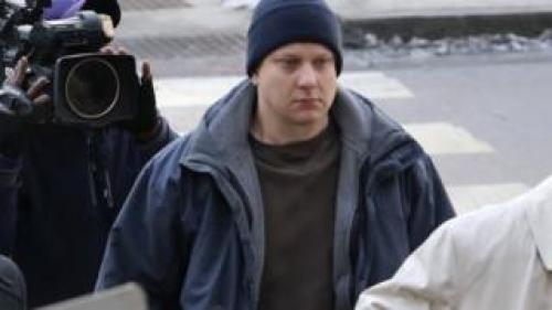 The officer who shot the black teenager, Jason Van Dyke, pictured above, turned himself in