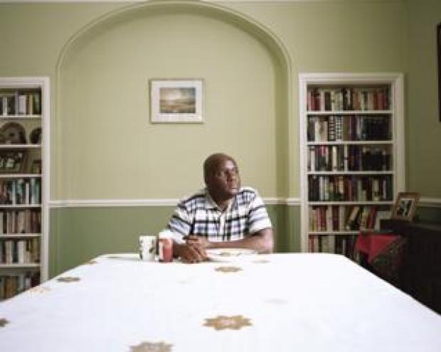 A man sits at the end of a table.