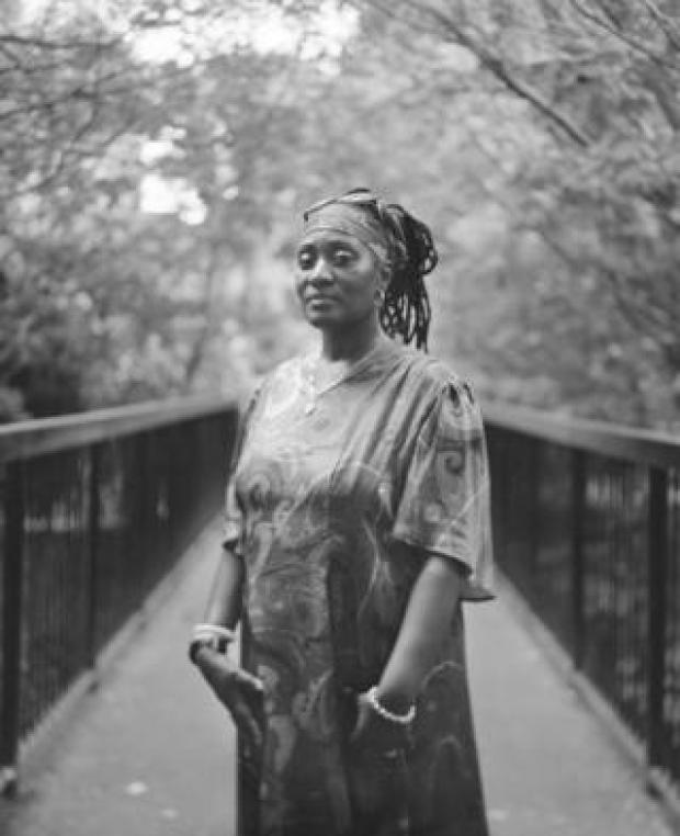 A woman poses for a portrait