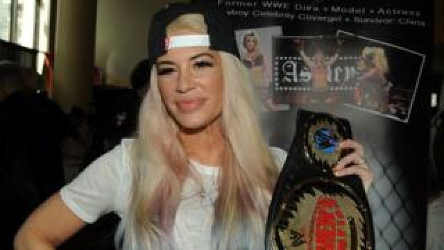 Ashley Massaro holding a WWE belt