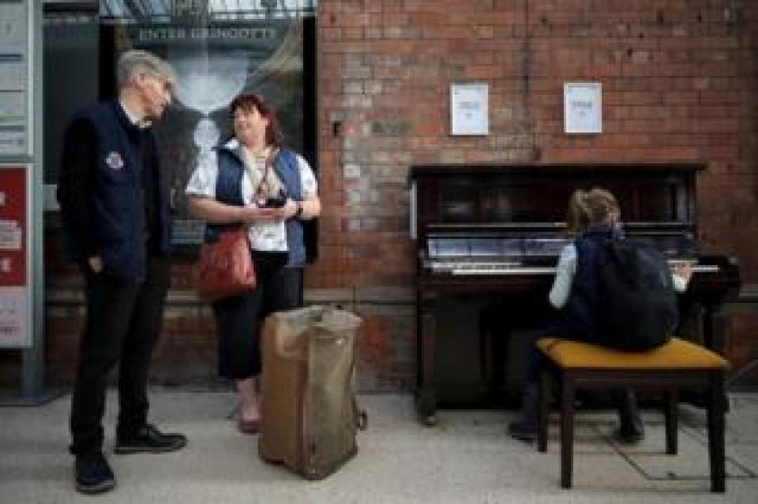 Malcolm Ingram, Jill Robinson and her daughter Katie Robinson at the Darlington piano