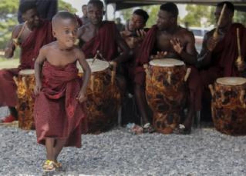 NEWS A boy dances as drummers in traditional dress perform at the Accra International Conference centre where the body of the late Kofi Annan has been laid in state in Accra, Ghana, 11 September 2018