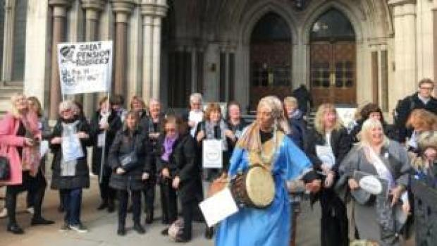 Campaigners celebrate outside the Royal Courts of Justice in central London