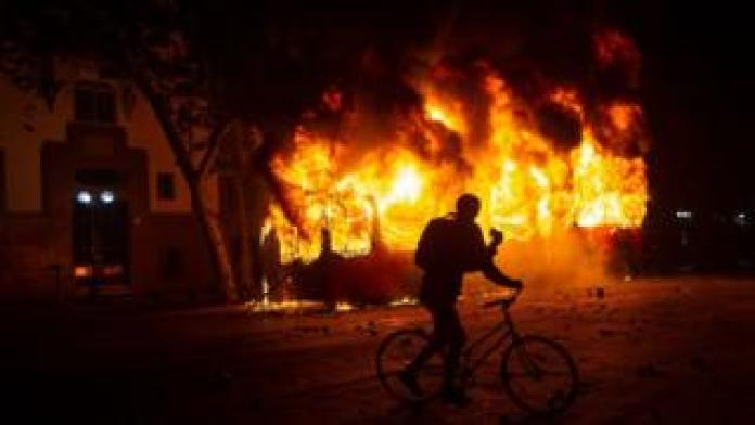 A bus burns down in downtown Santiago
