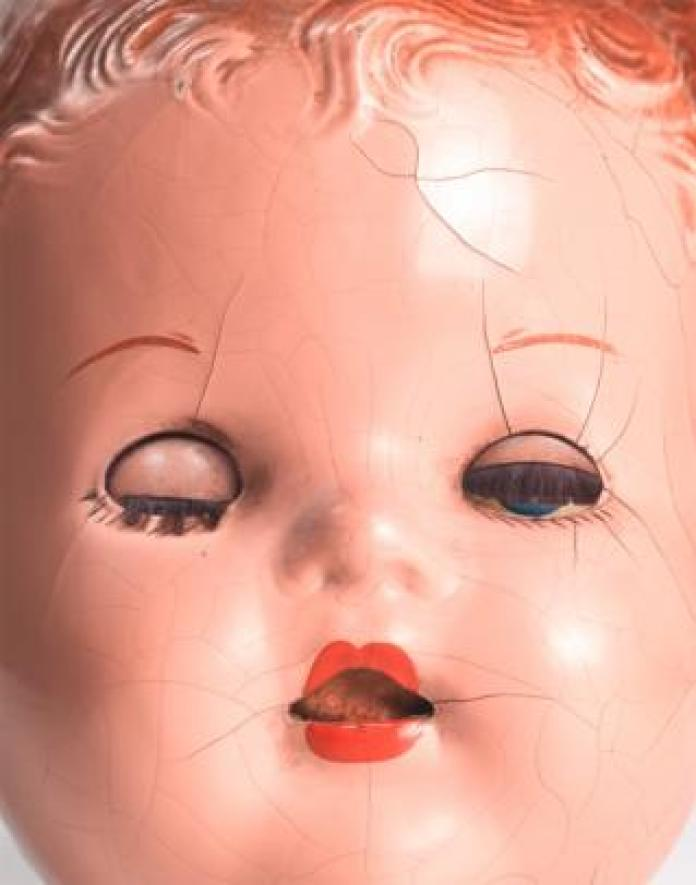 A close-up of a doll's face