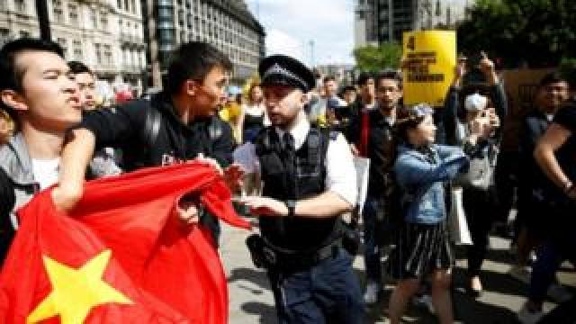 Pro-Beijing demonstrators are separated from supporters of the Hong Kong protestors in London