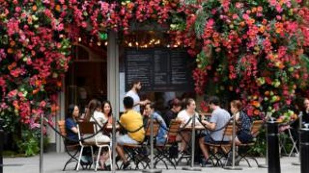 People sitting outside a restaurant