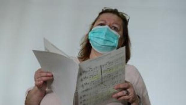 Singer in a face mask