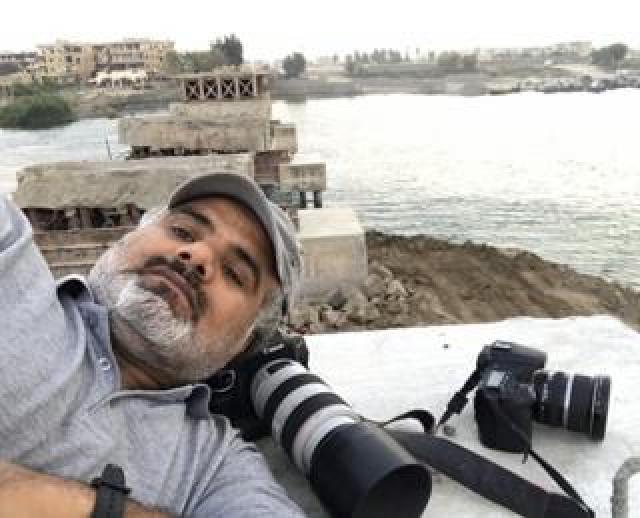 Abood Hamam on ruined bridge