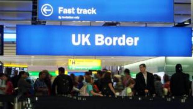 Passengers going through the UK Border at Terminal 2 of Heathrow Airport