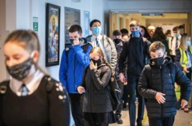 """Students at St Columba""""s High School, Gourock, wear protective face masks as they head to lessons as the requirement for secondary school pupils to wear face coverings when moving around school comes into effect across Scotland"""