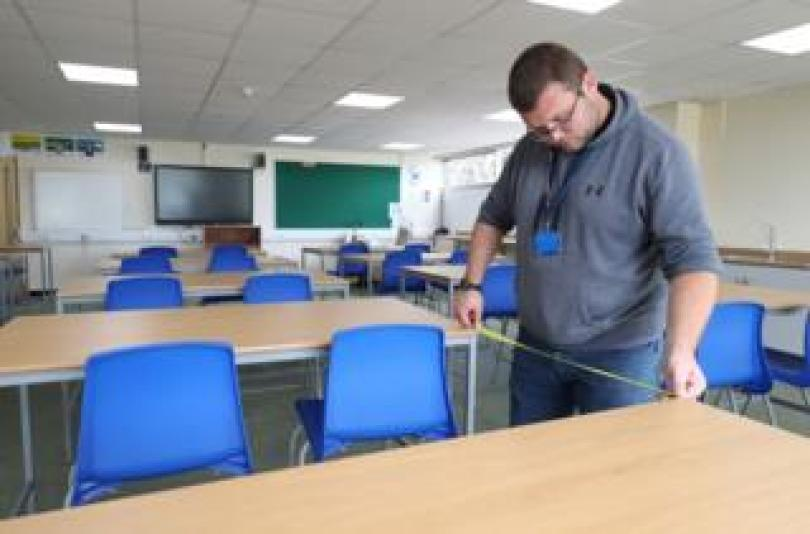 Wed Aug 26, 2020. Table gaps are measured in a class room, as preparations are made for the new school term at Alderwood School in Aldershot, Hampshire.