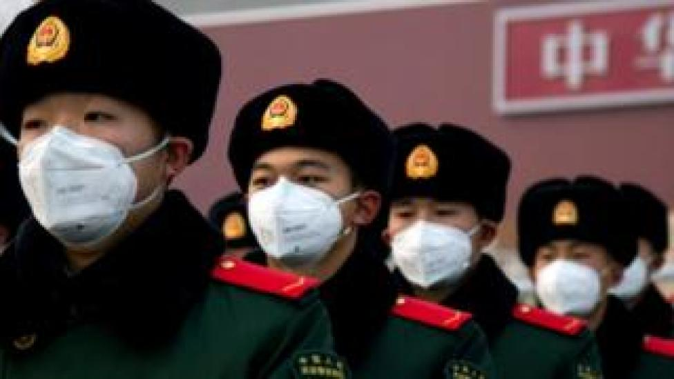Chinese police officers wearing face masks