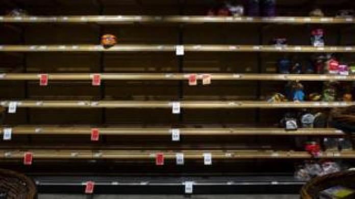 An almost-empty grocery shelf