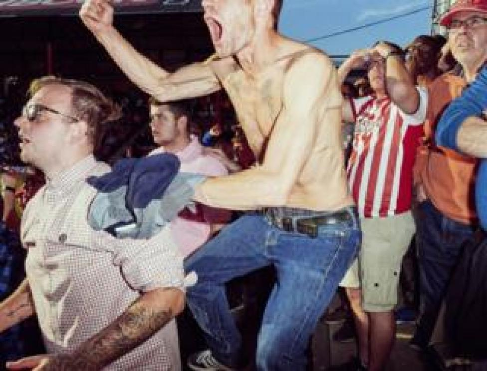 37-year-old Craig Nickels rejoices with his friends in the very last minutes of a match at Brentford Football club in West London.