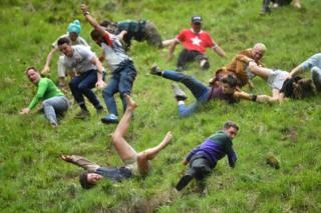 Participants take part in the annual cheese rolling competition