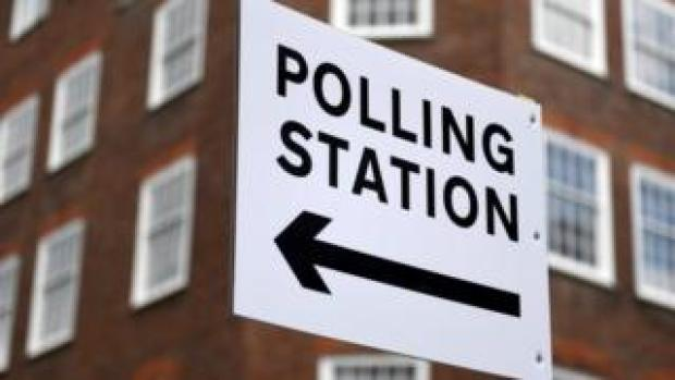 Sign directing people to a polling station in London
